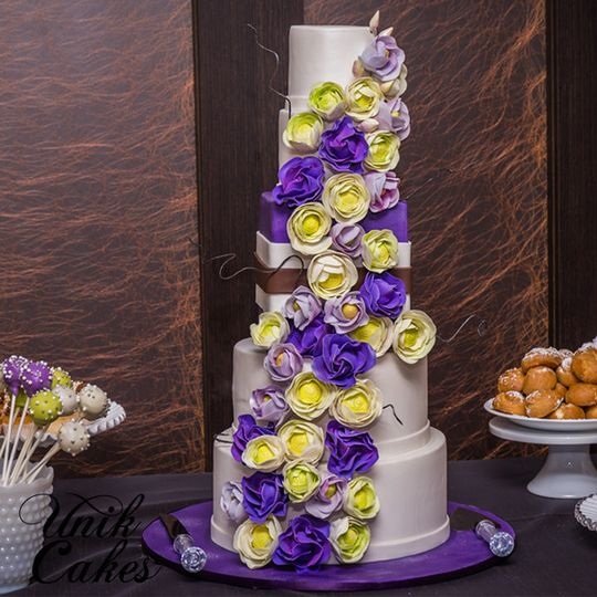 Wedding cake with purple and yellow flowers