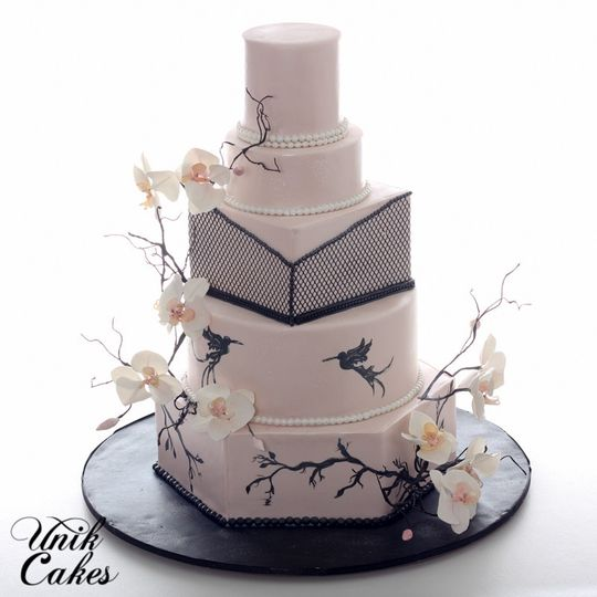 Beautiful wedding cake with white flowers