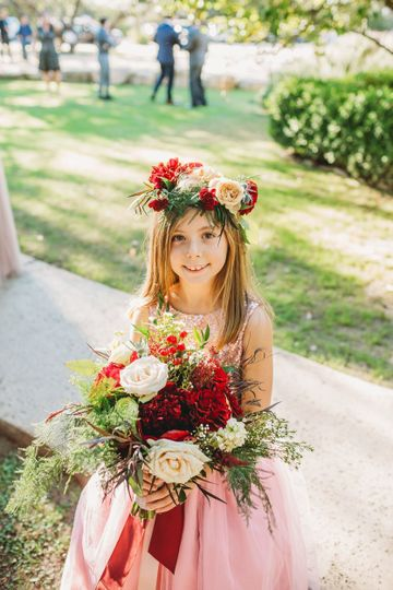Flower girl with a flower crown and bouquet