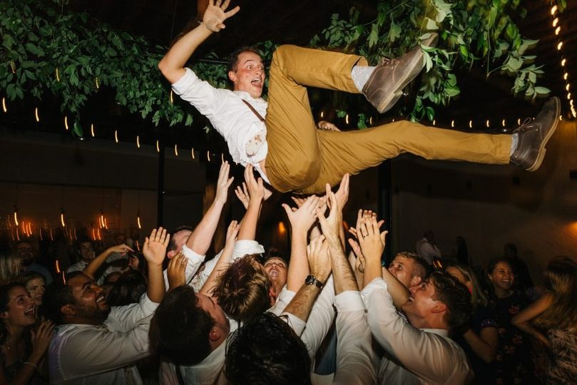 Crowd-surfing groomsman