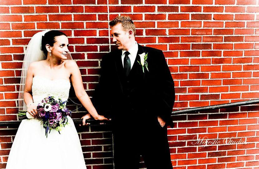 brick wall bride groom