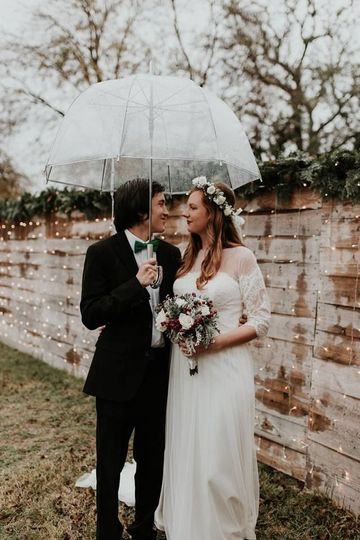 Newlyweds share an umbrella