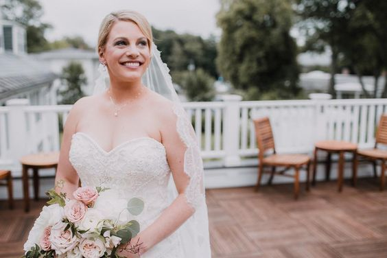 Blushing bride on the rooftop