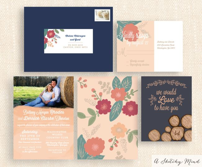 A romantic, country-themed wedding invitation suite featuring navy blue and coral color scheme with...