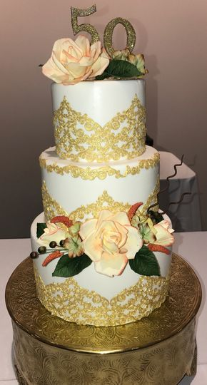 A special gold and yellow rose day. Sugar flowers lace and fondant covered