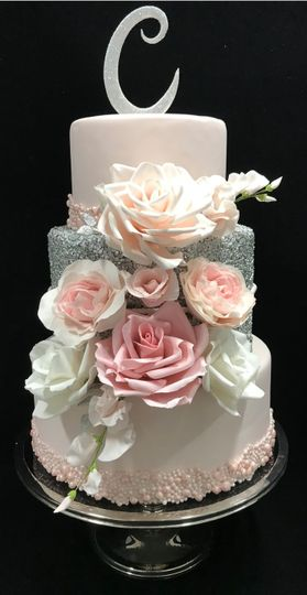 Pretty in Pink, Fondant covered and sugar sparkle middle tier with sugar flowers