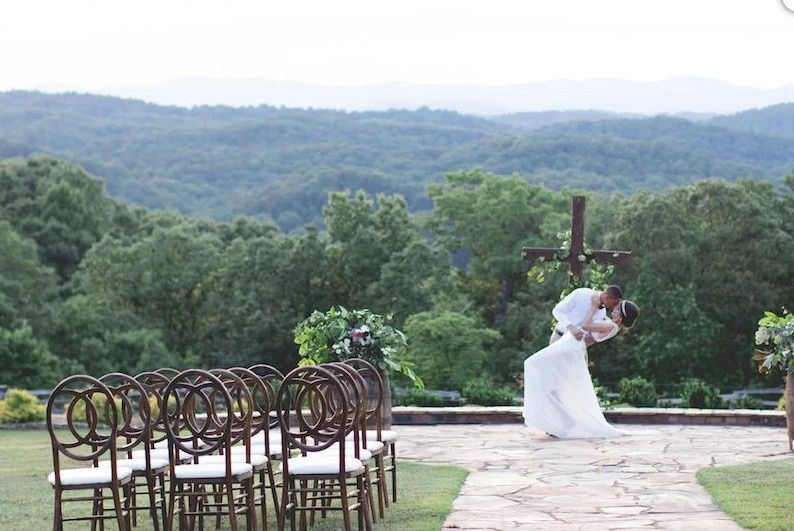 The couple in the outdoor wedding venue