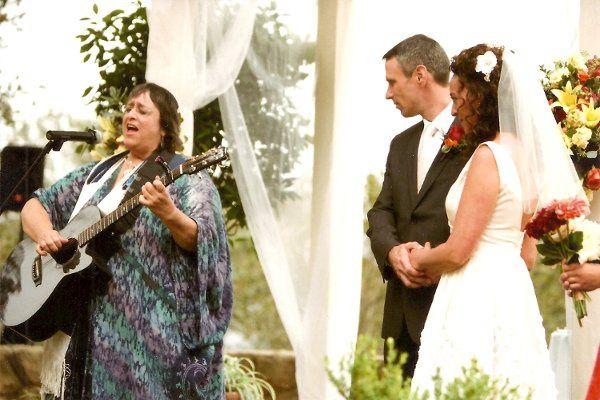 Ter singing/playing guitar at Tami and Tim's wedding