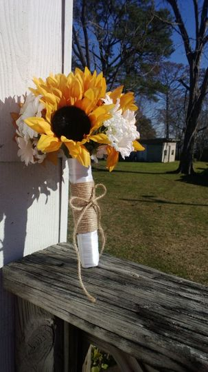 Sunflowers. daisies, babies breath, wrapped in white satin ribbon with natural twine. $35