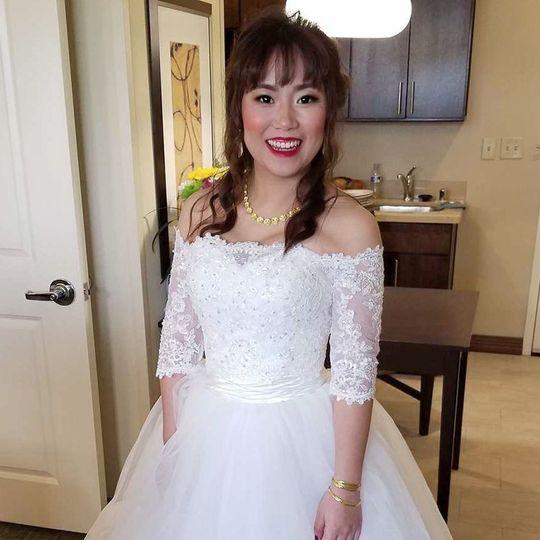 Bride in off-shoulder sleeved dress