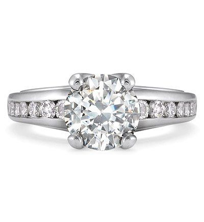 Platinum solitaire for a 2.0 to 3.0 carat round center stone. Channel set with 12  1.8mm to 2.4mm...