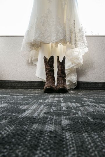 Wedding prep boots and dress
