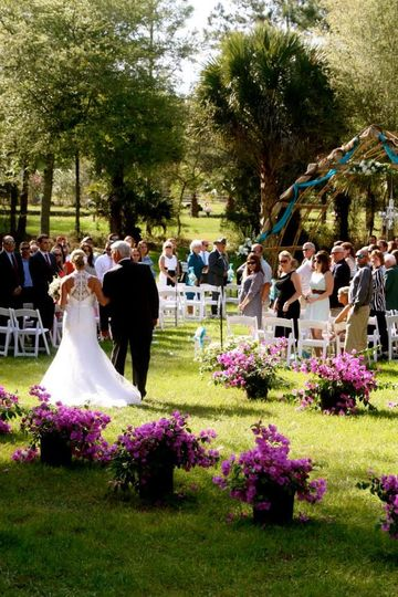Coming down the aisle to the portable arch