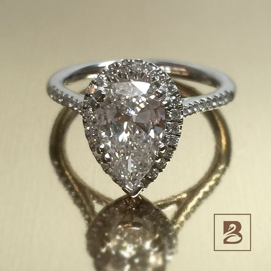 Pear shaped single stone ring