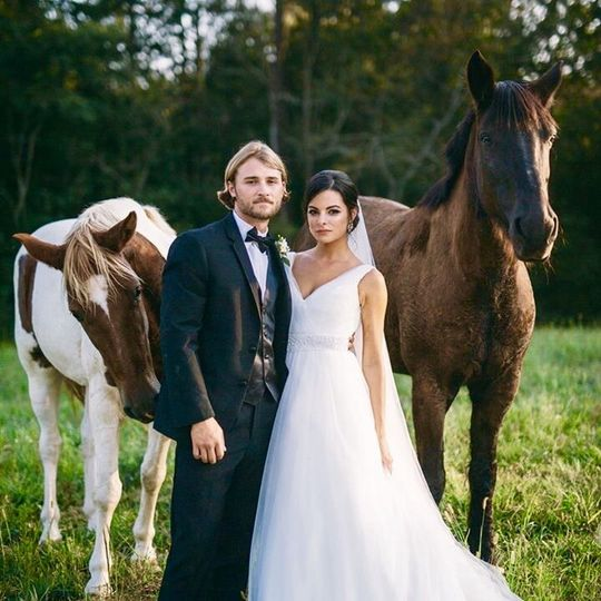 Newlyweds with the horses