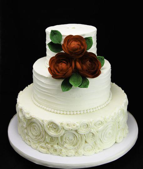 rosettes ranunculus wedding cake