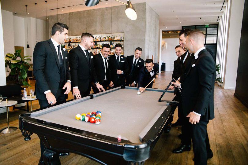 Groomsmen enjoy a round of pool