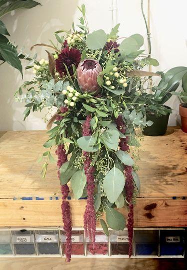 Wedding bouquet with burgundy flowers