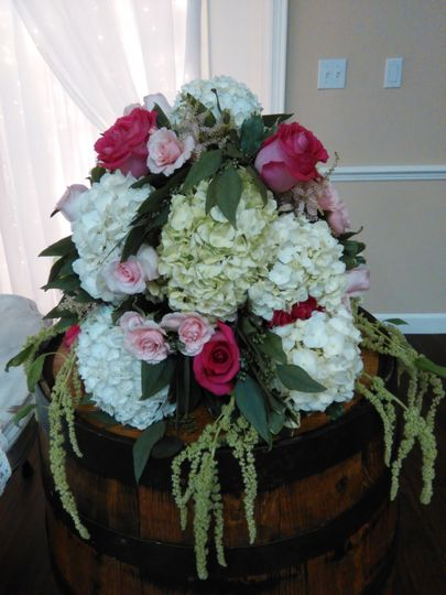 Alter arrangements including roses, spray roses, eucalyptus, hydrangea and hanging amaranths