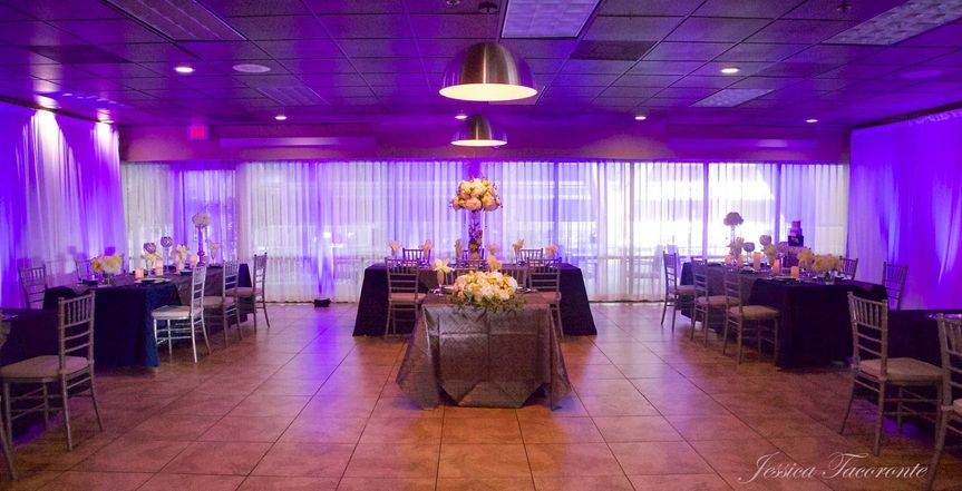 Private restaurant space with wall drape and uplighting in blue