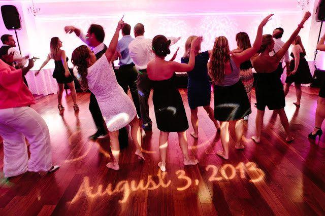 DJ Kurt Etheridge participating in a soul train line dance at a wedding at the Yacht Club at Marina...