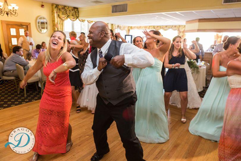 DJ Marcus Matthews teaching a line dance.  Astro DJs can teach today's popular line dances if...