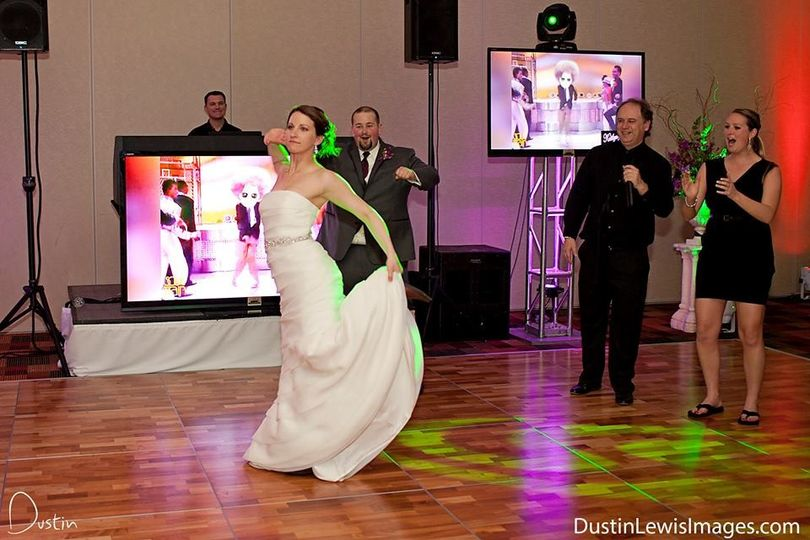 Astro DJs Larry D and Steve Weddle observing a bride breaking loose on the dance floor!