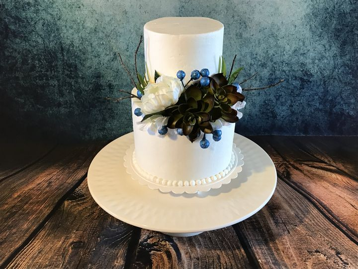 Buttercream wedding cake with blue floral notes