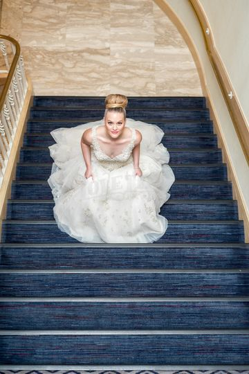 This custom wedding gown featured layers of flowing fabric and a magnificent veil