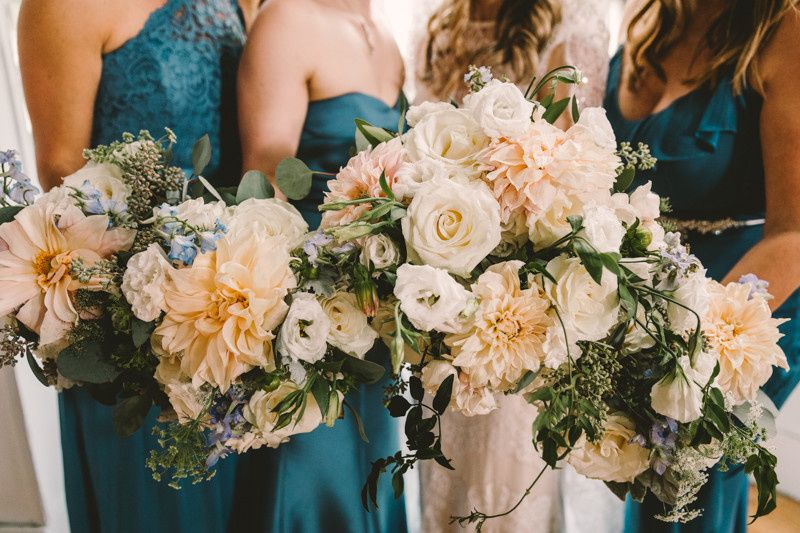 Nature of Design created soft coral and cream tones for our bridesmaids bouquets