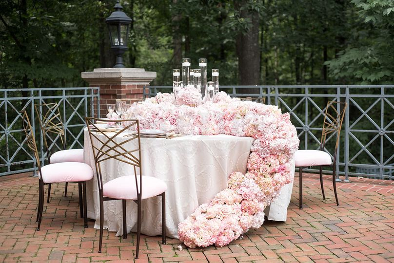 BCG Florals created this custom look for our bridal table filled with pink roses and accented by...