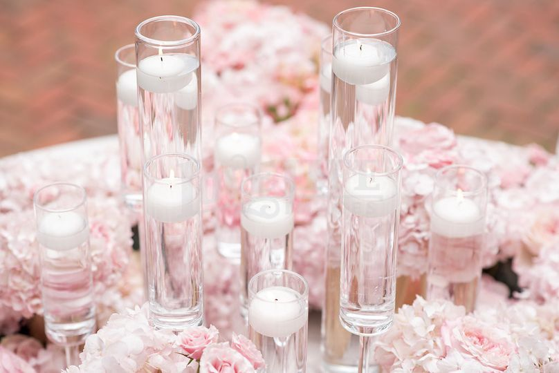 Cylinder vases with floating candles in different heights always add a romantic touch and dimension...