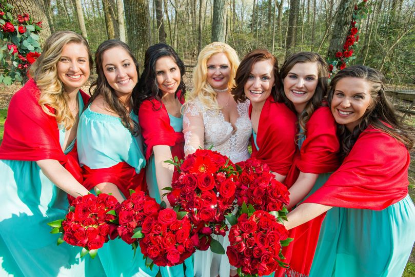 Our bride loved the mix of bold reds with cool aqua hues