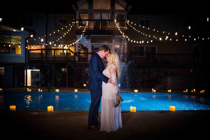 Bistro lights and a lit pool provided the ultimate wedding backdrop for these newlywed photos