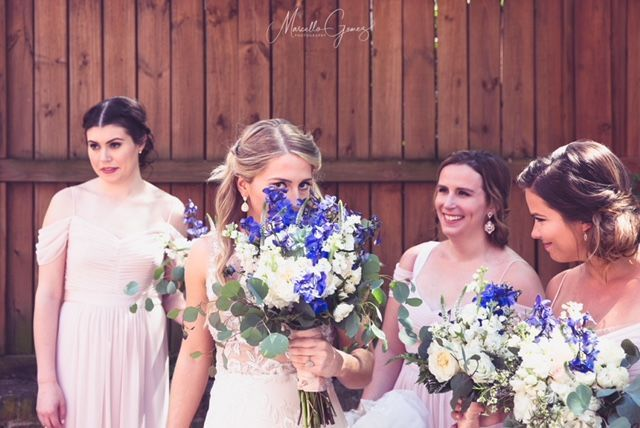 Our bride held a bouquet mixed with wildflowers and accented with eucalyptus leaves