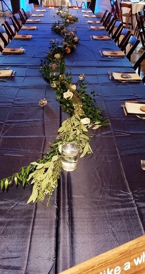 Long tables with greenery