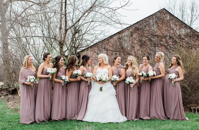Bridesmaids in front of shed