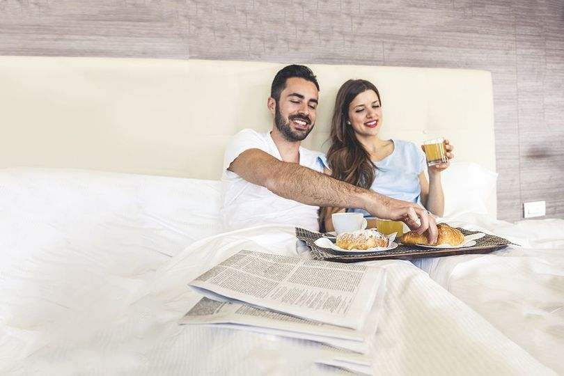 The couple on their breakfast in bed