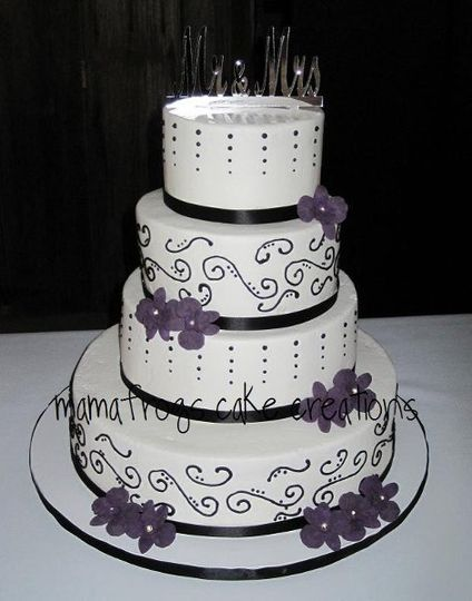 Buttercream cake, black scrollwork and piped details, black ribbon border and purple gumpaste...