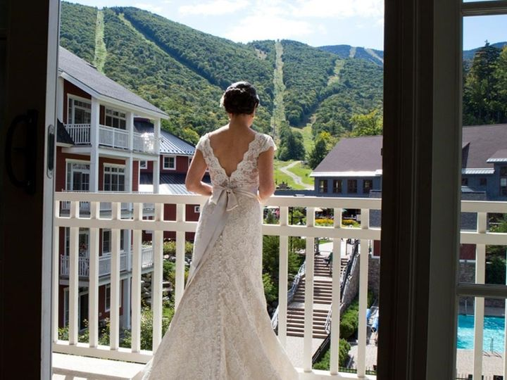 Bride looking outside the balcony