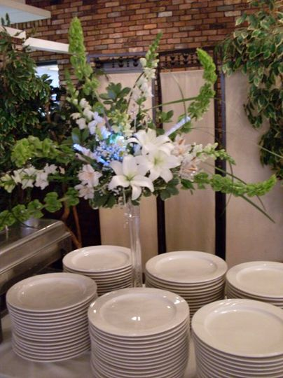 Buffet arrangement. Bells of Ireland, lilies and snapdragons with crystal sprays and fiber optic...
