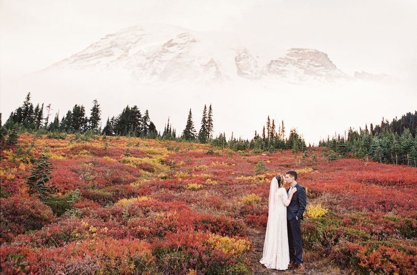 Couple kissing - Rustic Chic Mt. Rainier Wedding