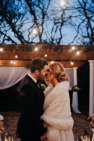 A passionate newlywed kiss