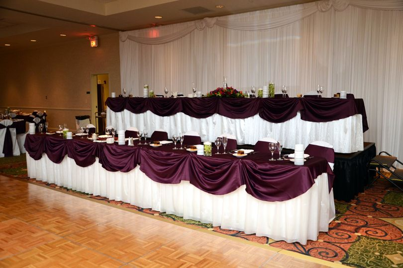 Rich purple-themed head table