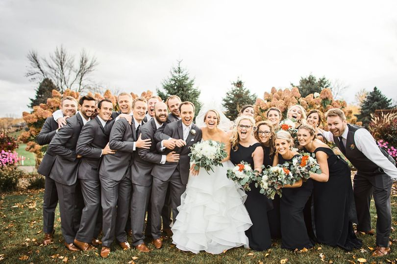 Newlyweds with their wedding party