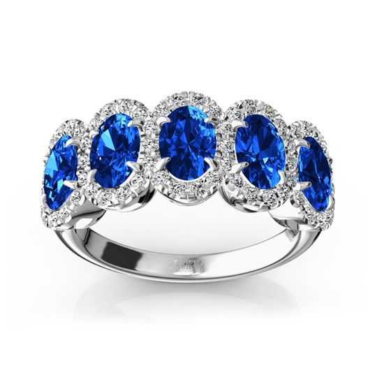 WB9268 Blue Ceylon sapphires set in eagle claw and framed with micro pave set brilliant round...