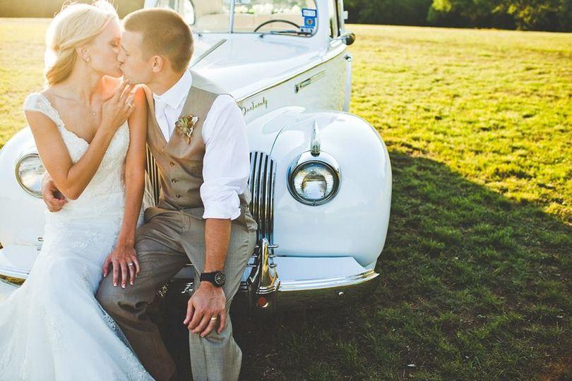 waco wedding kissing in a field w car