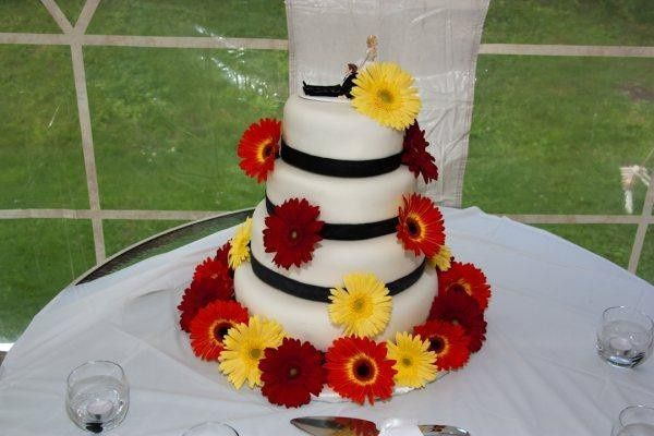 Fondant Wedding Cake with Gerber Daisys by Laura Lee's Cakes
