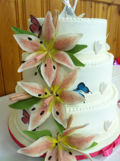 Wedding cake with buttercream icing, gumpaste Stargazer lily's, pearl brushed Hearts and wafer paper...