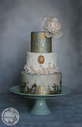 gold leaf blue white wedding cake